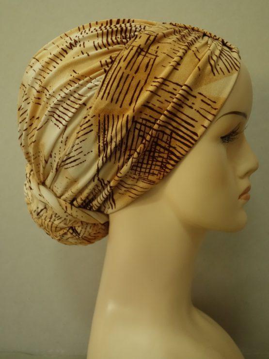Beżowy drapowany turban we wzory
