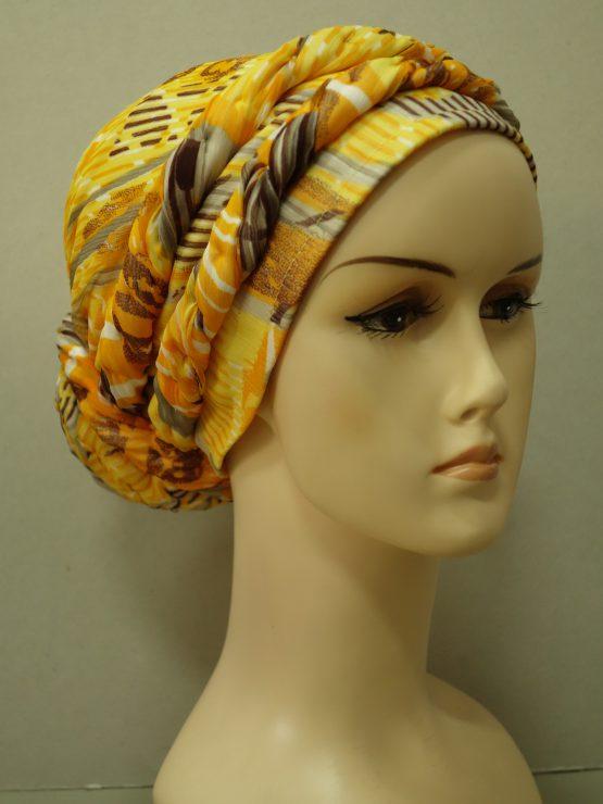Słoneczny turban z plecioną dekoracją